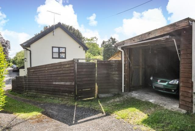 Driveway leading to garage at the rear