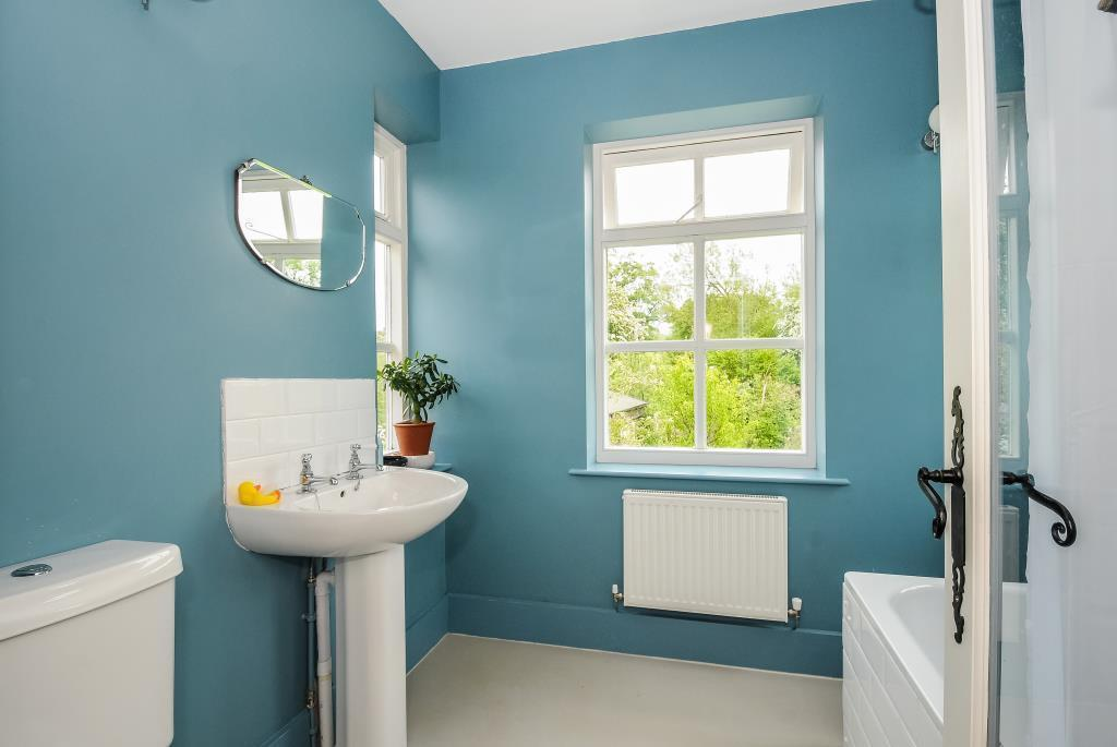Bathroom with white suite