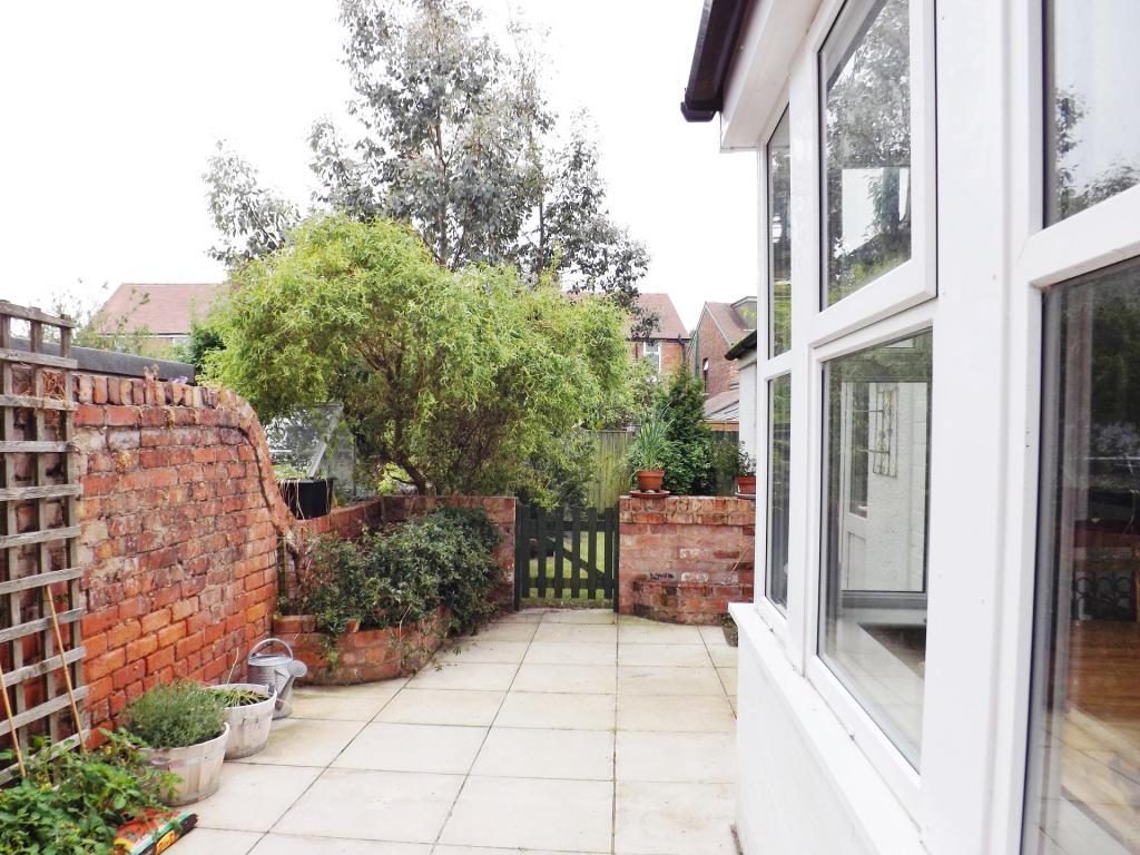 Side yard leading onto garden