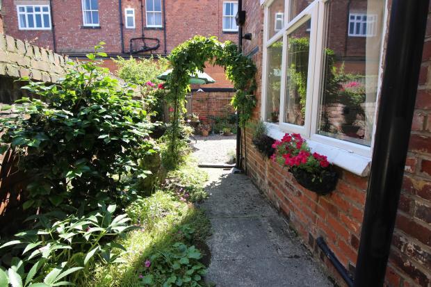 Side entrance to small quaint garden