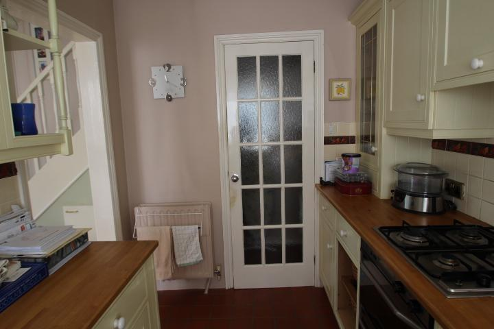 Kitchen with door into utility room