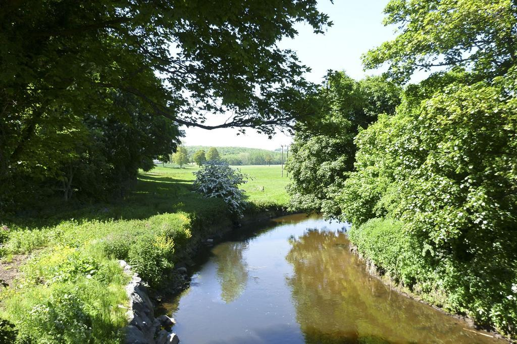 Canal running through the countryside in Stone