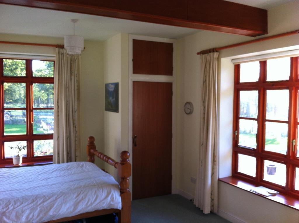 Downstairs bedroom or summer room. Very light with
