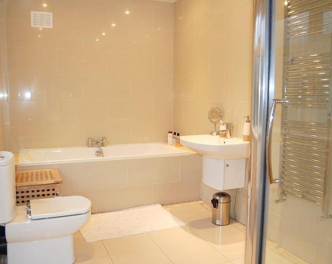 photo of contemporary beige bathroom with big tiles radiators tiles