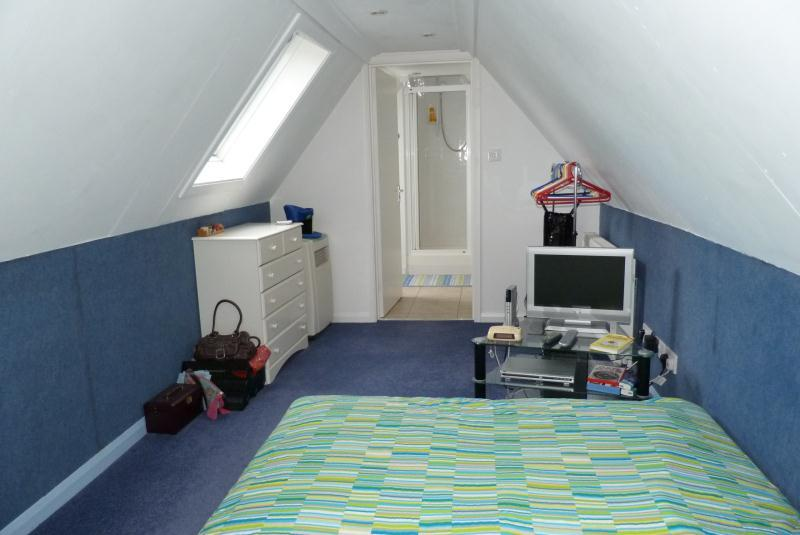 photo of blue white loft conversion