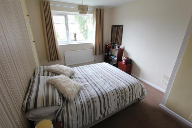 BEDROOM ONE TO FRONT