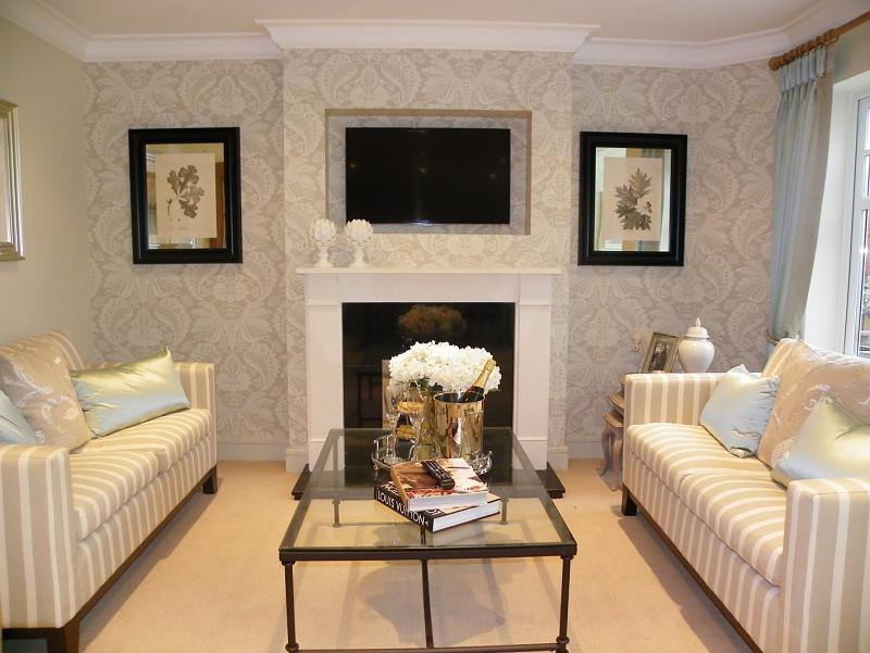 beige living room lounge with feature wall wallpaper and coffee table