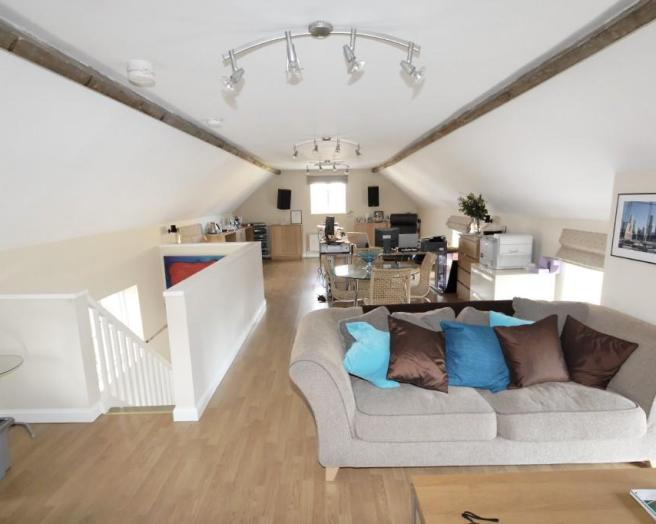 photo of open plan beige white living room