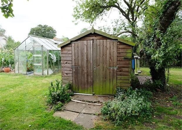 Wooden sheds & greenhouse