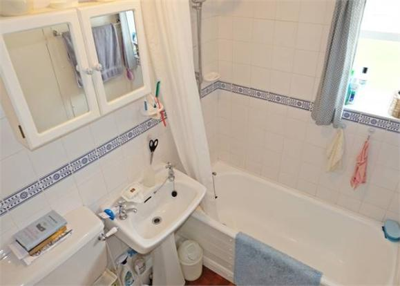 Bathroom with shower over the bath