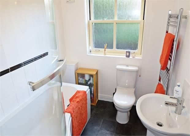 Bathroom with separate shower over the bath