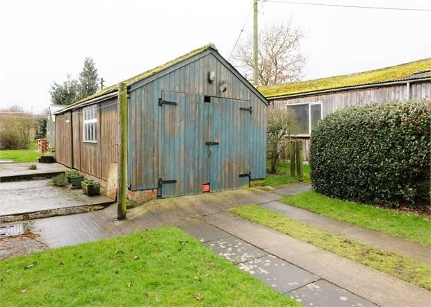 Detached wooden garage workshop