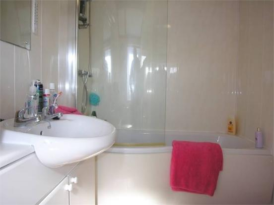 Bathroom with seperate shower over the bath