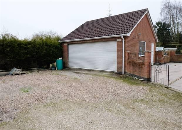 Detached double garage and workshop