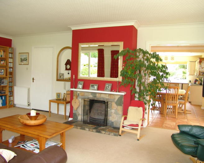photo of beige red living room with chimney breast and crazy paving