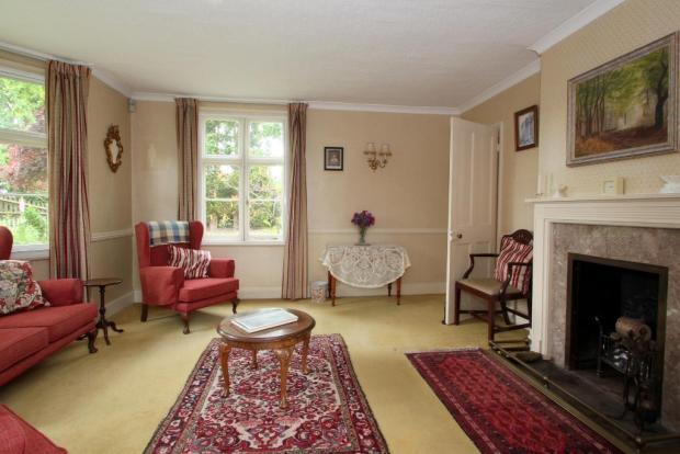 Lounge has fireplace and bay window