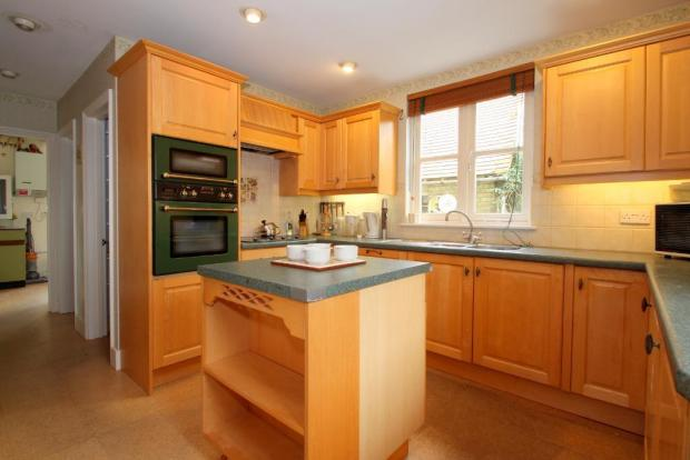 Kitchen with passage to Utility Room
