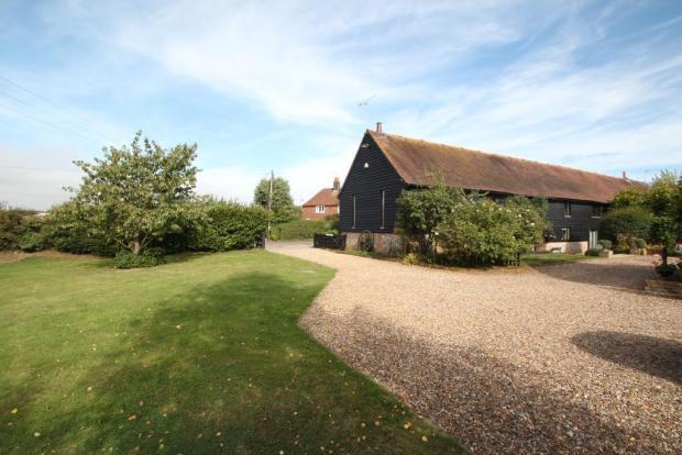 Extensive driveway adjoins lawned garden