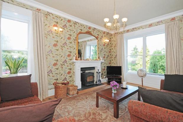 Dual Aspect Sitting Room With Woodburning Stove