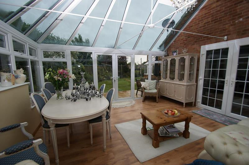 photo of blue brown white conservatory
