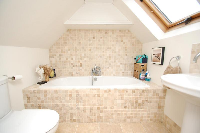 photo of contemporary simple beige white bathroom loft conversion with mosaic