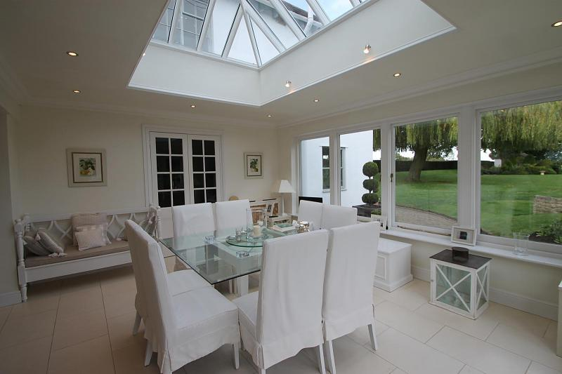 photo of white conservatory and glass table