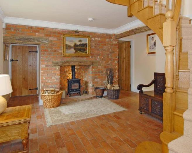 Entrance hall with fireplace log burner staircase stairs wood burner