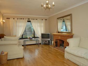 photo of beige exposed brick lounge with flooring brick fireplace fireplace laminate flooring leaded windows wooden floor