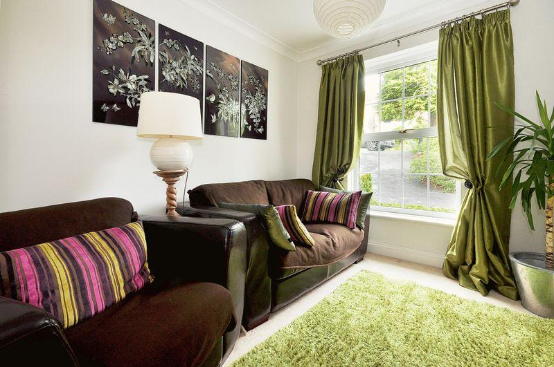 photo of cream olive white living room with cushions soft furnishings