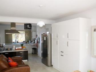 photo of open plan white dining room kitchen kitchen/dining room living room studio with storage and double fridge
