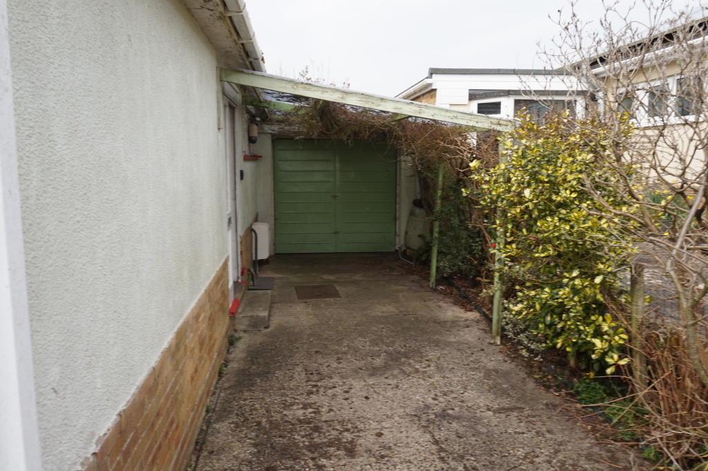 Drive, carport and garage