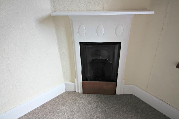 Fire place in bedroom.