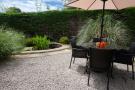 Side Garden with Pond. Main Street. Warton. Carnforth Estate Agents. YOPA