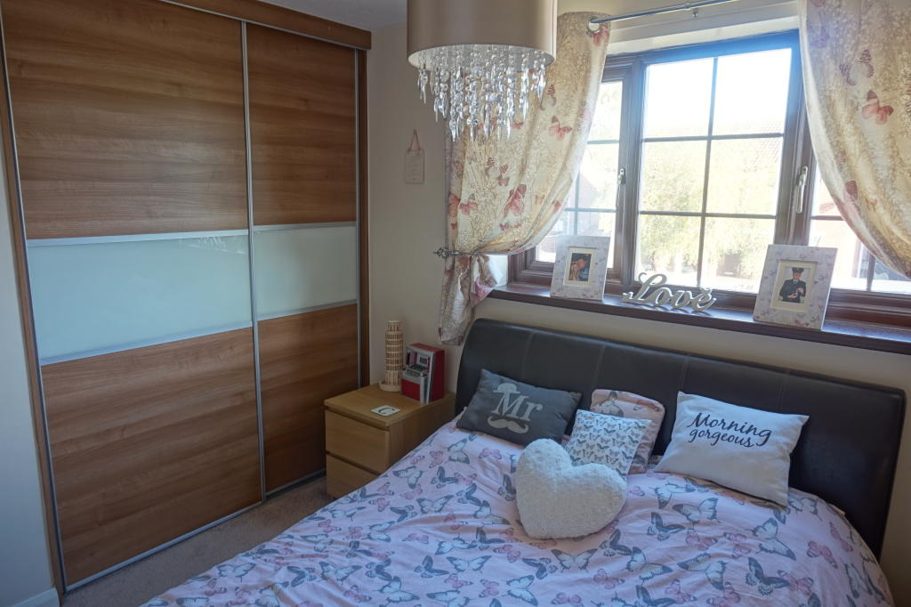 Bedroom one - fitted wardrobes