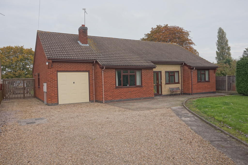 Front - long drive, ample parking, gated side vehicular access