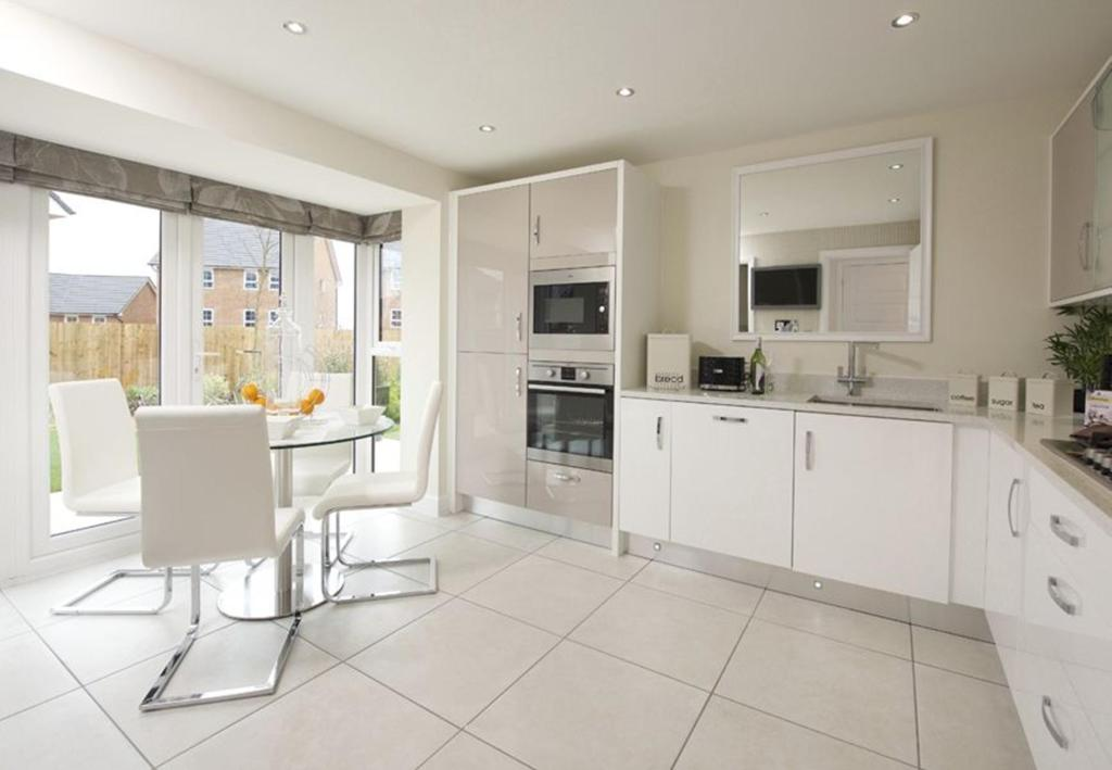 Typical Warwick breakfast area and French doors to the fitted kitchen