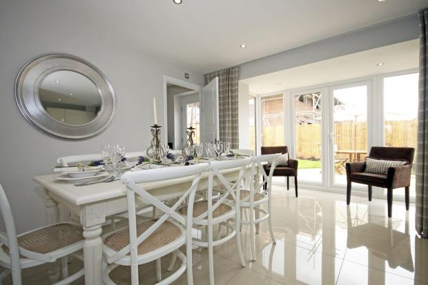 Typical Guisborough dining area with glazed bay and French doors