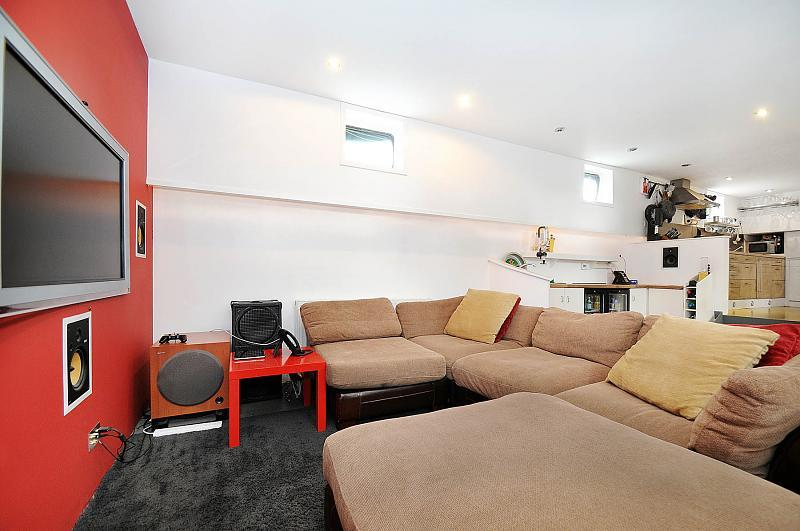 photo of open plan beige red white living room lounge and corner sofa
