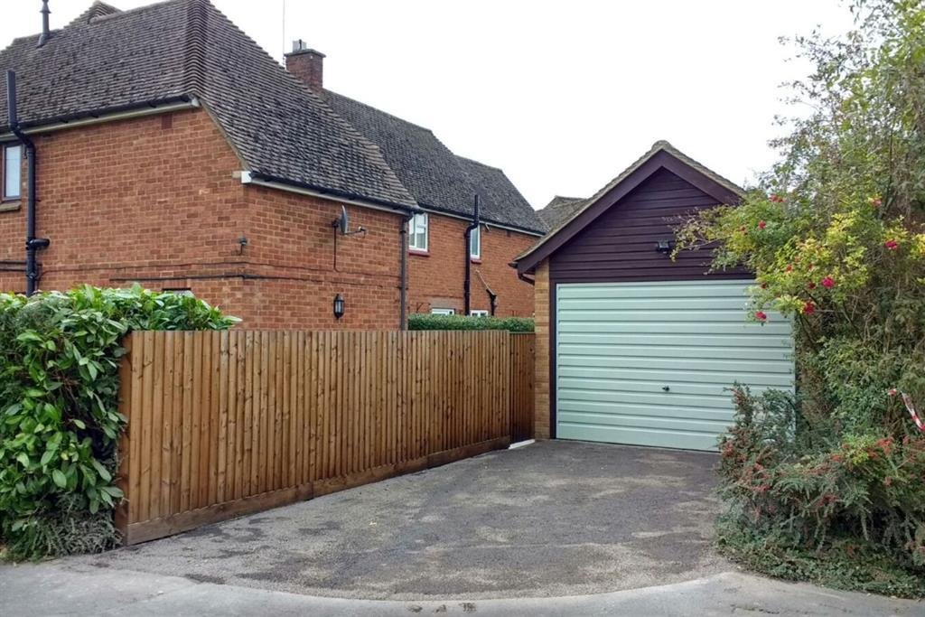 Detached Garage and Driveway