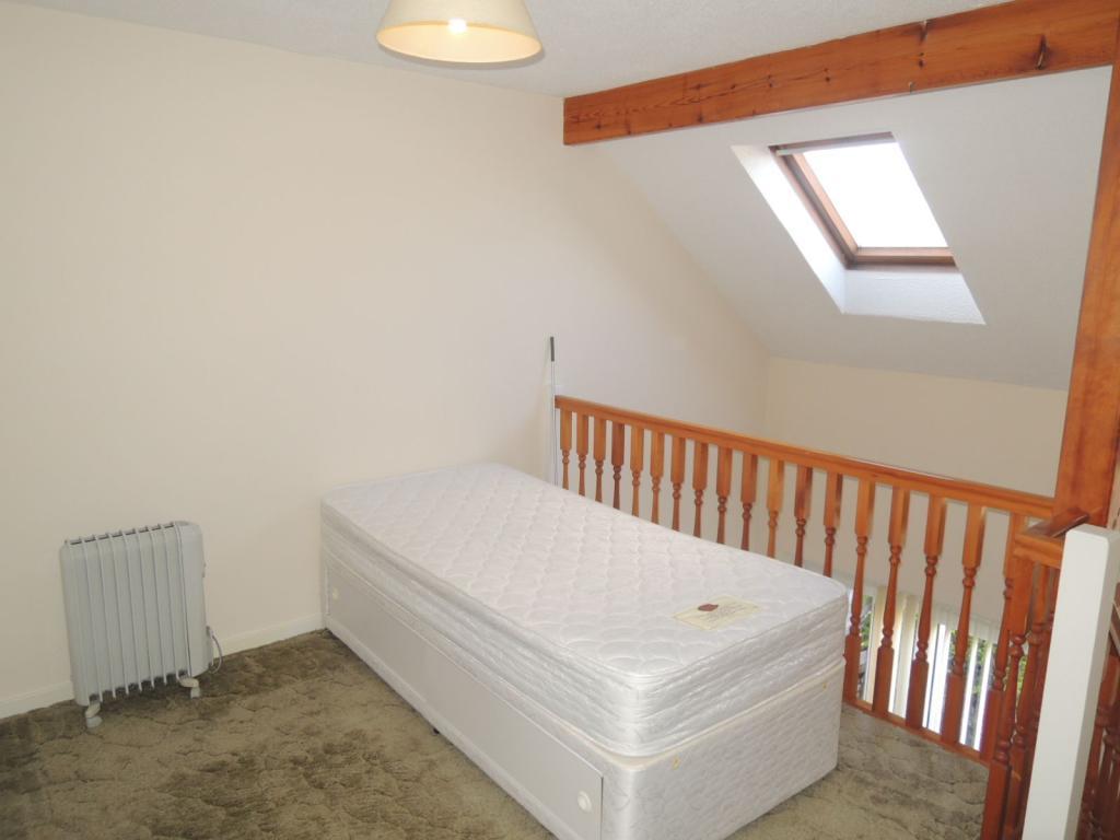 FIRST FLOOR: GALLERIED BEDROOM
