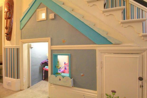 Under stairs house