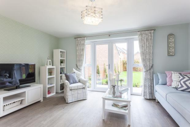 Typical Barwick living room with French doors