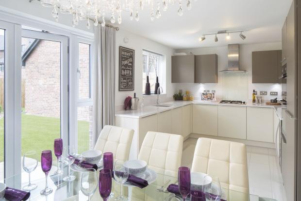 Typical Kington fitted kitchen and dining area with French doors