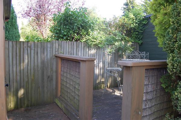 West Facing Decking area & Log Store