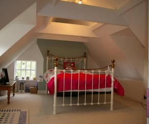 photo of bedroom loft conversion with gabled ceiling