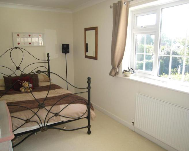 photo of neutral beige white bedroom with carpet carpeted