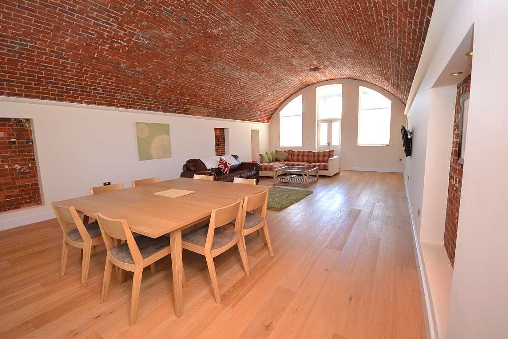 contemporary apartment with brick barrel vault ceiling