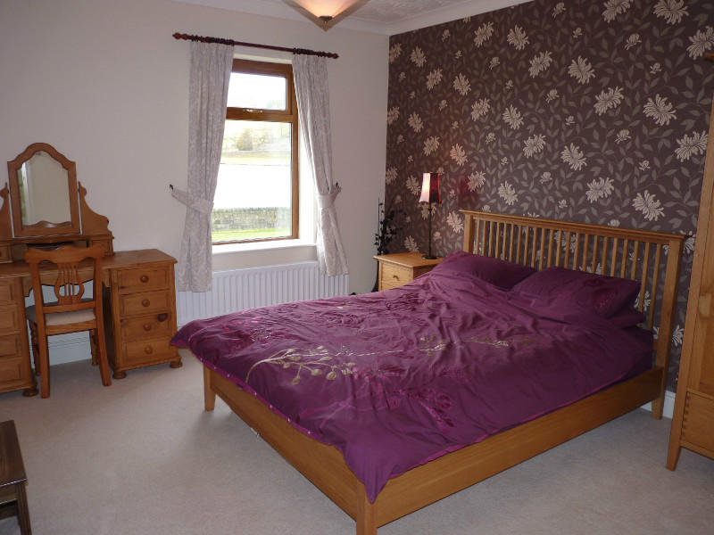 photo of brown pink purple white bedroom with feature wall wallpaper