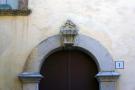 Carving above door