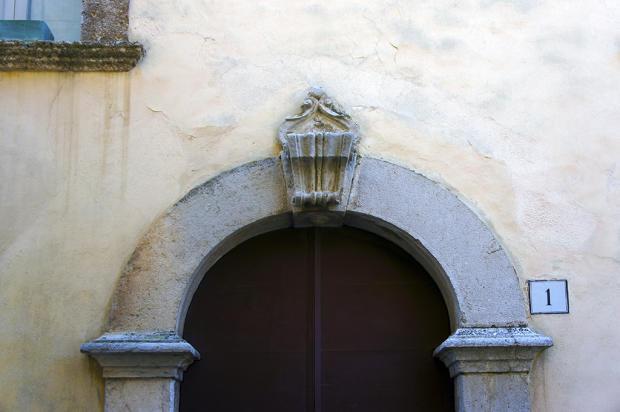 Crest above door